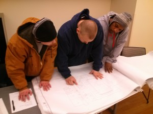 Students read a blueprint in the classroom