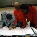 Students studying blueprints