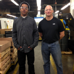 Two workers in a manufacturing facility