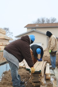 Foundations for the Trades Academy students measuring on a job site