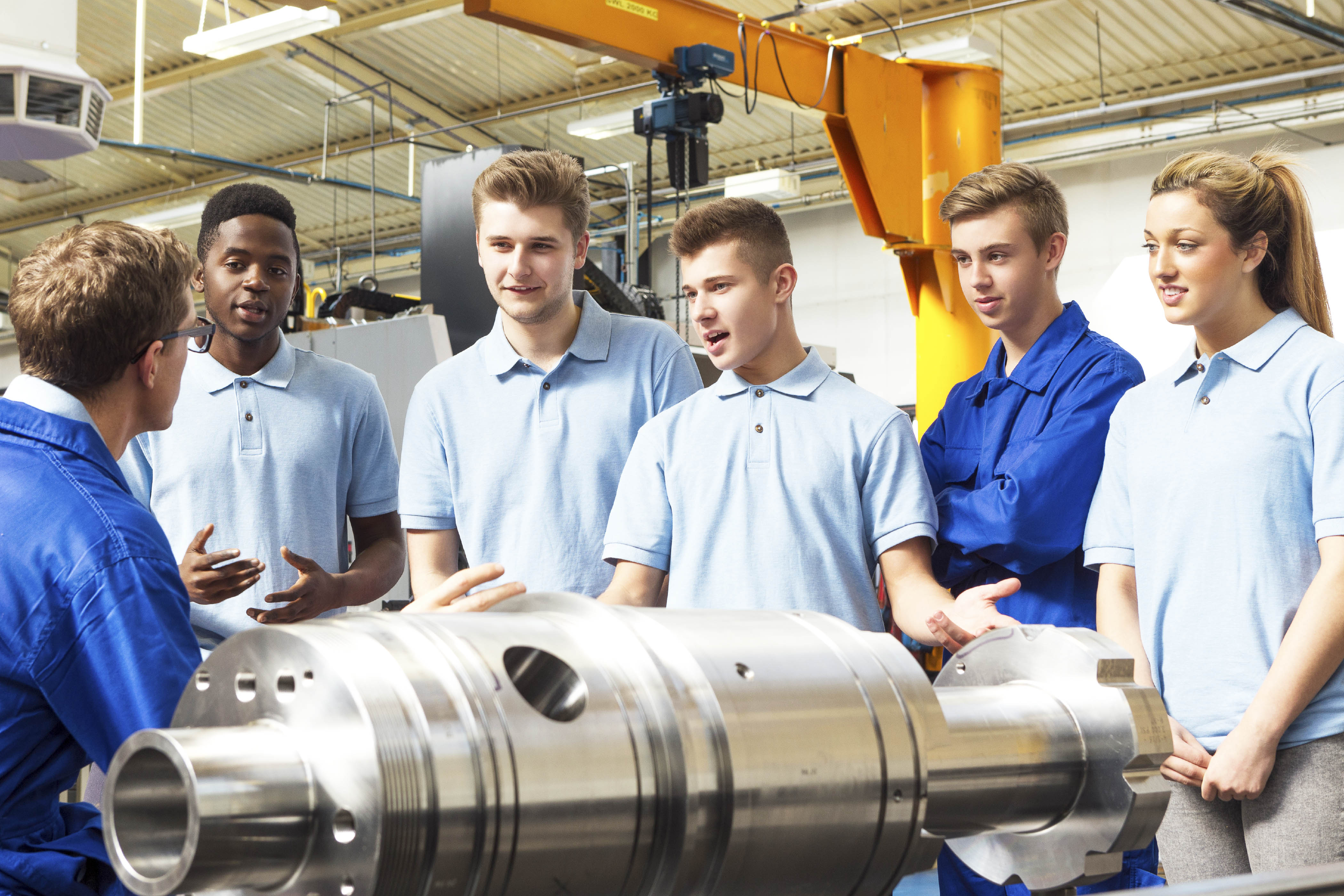 Students tour a manufacturing facility
