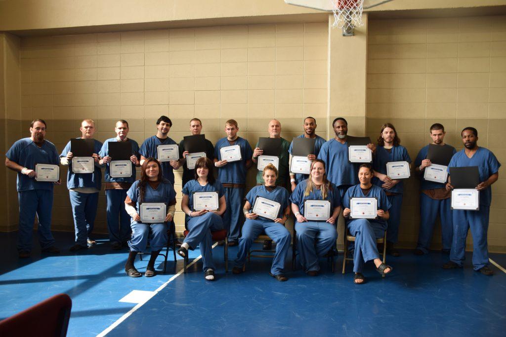 The Windows to Work graduates pose with their diplomas.