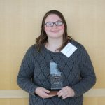Allison Burcham poses with her Aspire Award.