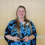 Andora Robertson poses with her Aspire Award.