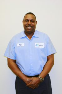 Rufus proudly shares his success story and shows off his Amcor uniform.