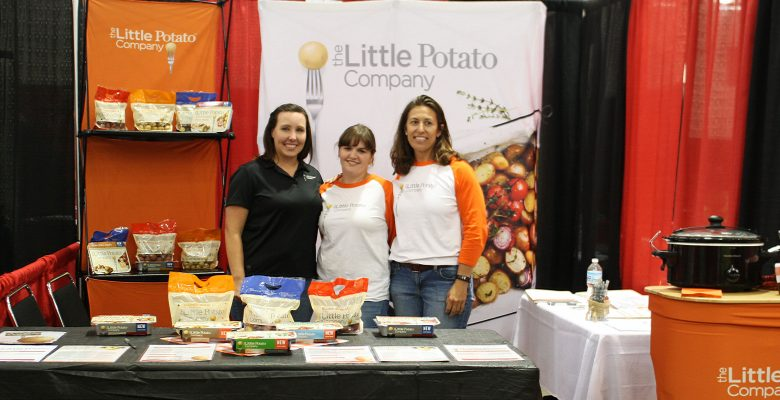 The Little Potato Company team promotes their company at the Dane County Job Fair.