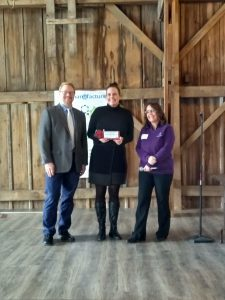 Danica Nilsestuen receives her award from the Dodge County MBA