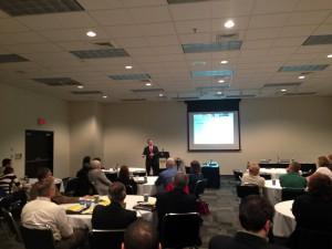 Steve Arndt of Exponent, Inc. speaking at the MW Summit