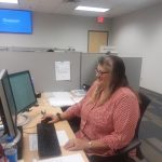 Micky at her desk at Glory Global Solutions