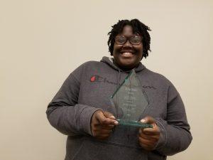 DeeDee poses with the Aspire Award