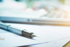 Pen on paperwork