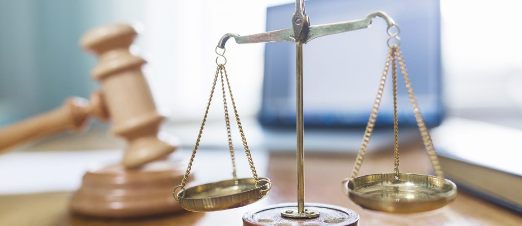 Golden justice scales in a courtroom