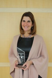 Pam Christenson poses with her Making a Difference Award.