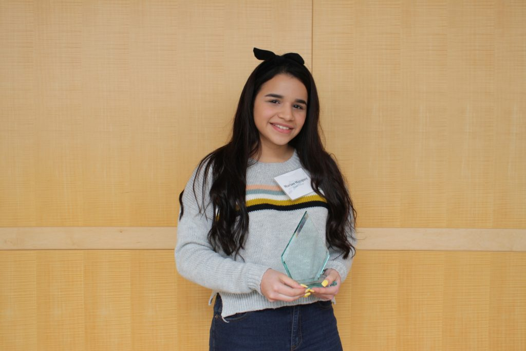 Marian poses with her Aspire Award.
