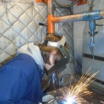 Middle College manufacturing student welding