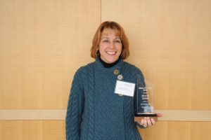 Colleen Rogers, on behalf of Madison-Kipp Corporation, poses with their Making a Difference Award.