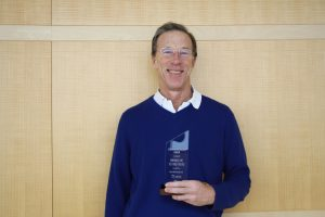 Paul Scharfman poses with his Making a Difference Award.